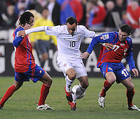 USMNT midfielder Landon Donovan (10) tries to keep possession of the ball while covered by Costa Rica defender Pablo Herrera (17) right and midfielder Michael Barrantes (6)  The USMNT tied Costa Rica 2-2 on the final game of the 2010 FIFA World Cup Qualifying round at RFK Stadium, Wednesday October 14, 2009.