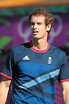 Andy Murray prepares to serve against Marcos Baghdatis.  Murray defeated Baghdatis (4-6) (6-1) (6-4) in the third round of the London Olympics tennis tournament on Wednesday, August 1, 2012 in Wimbledon, England (AP Photo/Margaret Bowles)