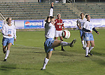 UNC's Kendall Fletcher (center) unsuccessfully tries to stop the ball from going out of bounds on Wednesday, November 2nd, 2005 at SAS Stadium in Cary, North Carolina. The University of North Carolina Tarheels defeated the University of Maryland Terrapins 3-1 during their Atlantic Coast Conference Tournament Quarterfinal game.