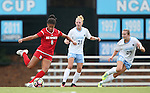 16 September 2016: NC State's Kia Rankin (8) is watched by North Carolina's Dorian Bailey (29) and Hannah Gardner (71). The University of North Carolina Tar Heels hosted the North Carolina State University Wolfpack in a 2016 NCAA Division I Women's Soccer match. NC State won the game 1-0.