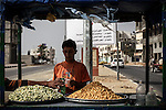 A Palestinian boy sells lupin beans in street in Gaza City on October 31, 2013. Photo by Ashraf Amra