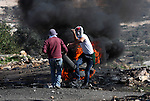 Palestinian protesters burn a tire on the sidelines of a demonstration against the expropriations by Israel in the West Bank village of Kafr Qaddum, near Nablus, on November 30, 2012. Photo by Nedal Eshtayah