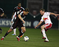 Josh Wolfe (16) of D.C. United barrels past Teemu Tainio (2) of the New York Red Bulls during an MLS match at RFK Stadium, in Washington D.C. on April 21 2011. Red Bulls won 4-0.