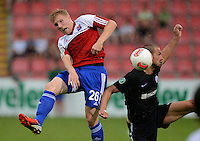 3. Fussball Bundesliga:  2. Spieltag    Saison   2012/2013   SpVgg Unterhaching  - FC Hansa Rostock   28.07.2012 Andreas Voglsammer (li, Unterhaching) gegen Matthias Holst (FC Hansa Rostock)