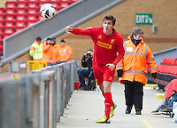 LIVERPOOL, ENGLAND - Easter Monday, April 1, 2013: Liverpool's Adam Morgan acts as ball-boy as the Reds chase the game 3-1 down against Tottenham Hotspur during the Under 21 FA Premier League match at Anfield. (Pic by David Rawcliffe/Propaganda)