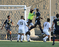 Andrew Quinn #0 of the University of Notre Dame  punches the ball away from Latif Alashe #21of the University of Michigan during a men's NCAA match at the new Alumni Stadium on September 1 2009 in South Bend, Indiana. Notre Dame won 5-0.