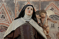 """Statue of St Teresa de Avila """"transverberada"""", San Blass Chaptel (Capilla de san Blas), Cathedral, Avila, Spain. Avila Cathedral, 11th-15th century, is regarded as the first Spanish Gothic Cathedral and its style is French influenced. Santa Teresa (1515-82), was a Carmelite nun, canonized 1622. Photograph by Manuel Cohen."""