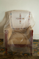 chair with a cross covered in plastic