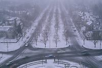 Shrouded in a light snow, Chapin Parkway is one of seven that were planned for the Buffalo, New York park system. In 1868, Frederick Law Olmsted and Calvert Vaux tried to integrate a system of parks and parkways for the first time. Olmsted designed the parkways so that within steps of each resident's door was the entrance to a park-like setting.