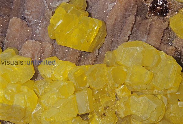 Sulfur crystals (S) on Aragonite, Sicily, Italy.