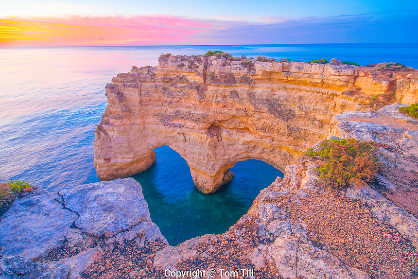 Heart Sea Arches at sunrise on Algrave Coast, Portugal, Atlantic Ocean   Near Lagoa