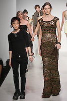 Senior fashion designer Stephanie Chudy walks runway with model, at the close of the Pratt 2011 fashion show.