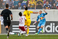 Kosuke Kimura (27) of the New York Red Bulls fouls Justin Meram (9) of the Columbus Crew in the box drawing a penalty kick. The New York Red Bulls and the Columbus Crew played to a 2-2 tie during a Major League Soccer (MLS) match at Red Bull Arena in Harrison, NJ, on May 26, 2013.