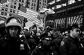 New York, New York<br /> November 17, 2011<br /> <br /> &quot;Occupy Wall Street&quot; protesters mark the movement's two-month milestone by marching from Zuccotti Park, in mass, to various access streets surrounding the New York Stock Exchange, which the police had barricaded off. Yet instead of the police keeping protesters out, protesters locked down those entrances to Wall Street and the New York Stock Exchange creating havoc as the police made more then 240 arrests to try and keep the streets open to normal traffic.<br /> <br /> Protesters begin their march stepping off from the Harriman Foundation Square down Cedar Street towards the NYSE.