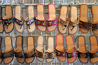 Women's slip on sandals in Mercado 28 souvenirs and handicrafts market in  Cancun, Mexico      .