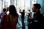 New  York, New York<br /> September 10, 2011<br /> <br /> Views of Ground Zero on the eve of the 10th anniversary of 9-11-2001. People look down at the site from Three World Financial Center.