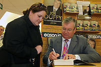 NO FEE PICTURES.15/10/11 Eason, Ireland's leading retailer of books, stationery, magazines and lots more, hosted a book signing byRTE presenter, Joe Duffy. Pictured at Eason,O'Connell Street, Dublin is Joe Duffy who signed copies of his new autobiography Just Joe..Follow Eason on Twitter @easons. Pictured with Joe Duffy is Jen O'Brien, Rathcoole Pictures:Arthur Carron/Collins