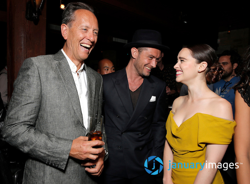 """Richard Grant, Jude Law and Emilia Clarke attend the party for Fox Searchlight's Premiere of """"Dom Hemmingway"""" at the Toronto International Film Festival on Sunday, September 8th, 2013 in Toronto, Canada. (Photo by Todd Williamson/Invision for Fox Searchlight/AP Images)"""