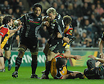 Justin Marshall is tackled by Richard Parks. Swansea Neath Ospreys Vs Newport Gwent Dragons, Magners league, Liberty Stadium © IJC Photography. Photographer Ian Cook