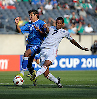 Cuba's Marcel Hernandez shoots on goal while being pressured by El Salvandor's Luis Anaya.  El Salvador defeated Cuba 6-1 at the 2011 CONCACAF Gold Cup at Soldier Field in Chicago, IL on June 12, 2011.
