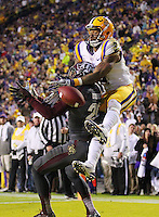 Nov 23, 2013; Baton Rouge, LA, USA; Texas A&M Aggies defensive back Deshazor Everett (29) breaks up a pass in the end zone intended for LSU Tigers wide receiver Odell Beckham (3) in the second half at Tiger Stadium. LSU defeated Texas A&M 34-10. Mandatory Credit: Crystal LoGiudice-USA TODAY Sports