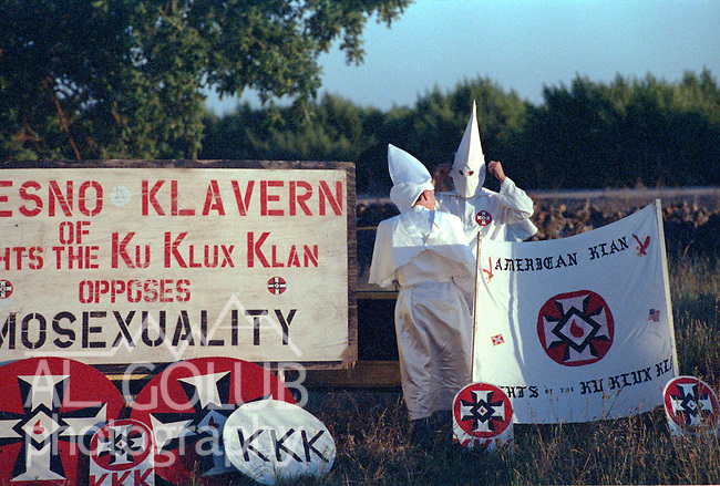 """Modesto -- Bill Albers, the grand wizard of the American Klan in Modesto, spoke to the audience, shouting """"white power!"""" at the end of his speech.  Two other speakers were Jim Cheney of the Federation of the Klans and Paul Nolff from the Aryan Nation.  Both came from Fresno.  That evening the groups gathered at Albers' home north of Modesto where a cross was burned.  June 10, 1995   Photo by AL GOLUB / Golub Photography"""