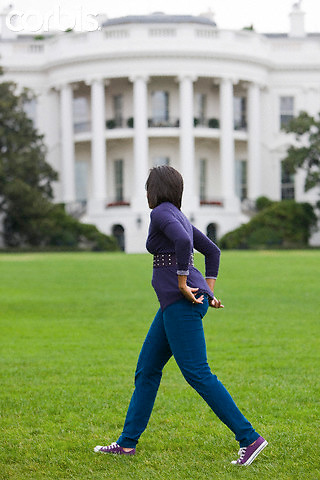 """29 Oct 2009, Washington, DC, USA --- """"First lady Michelle Obama walks back to the White House after harvesting vegetables from the Kitchen Garden on the South Lawn.                                        """" --- Image by © Brooks Kraft/Corbis"""