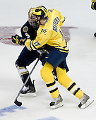 Ryan Thang (Notre Dame - 9), Mark Mitera (Michigan - 17) - The University of Notre Dame Fighting Irish defeated the University of Michigan Wolverines 5-4 in overtime in their 2008 Frozen Four Semi-Final matchup on Thursday, April 10, 2008, at the Pepsi Center in Denver.