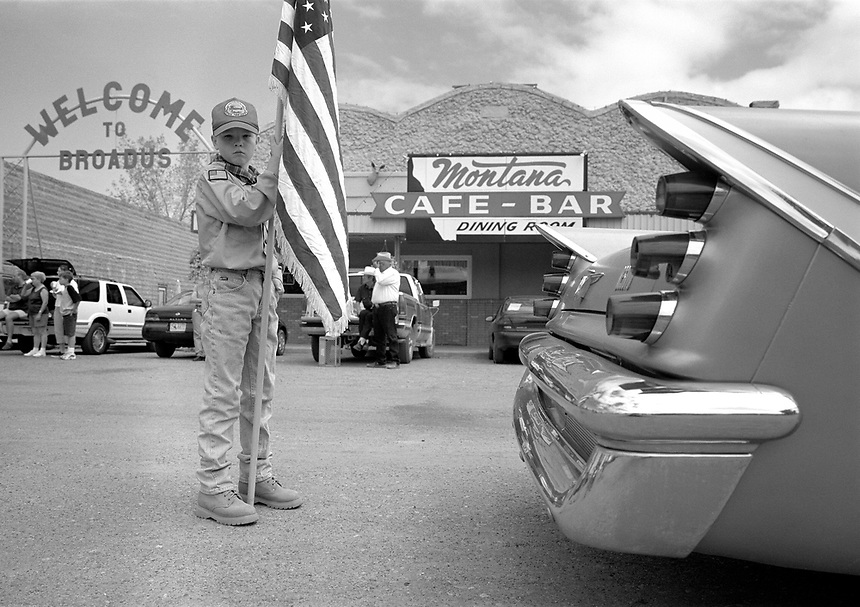 A young Boy Scout parades in the annual July 4 parade in Broadus, Montana.
