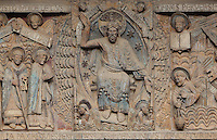 Christ enthroned as judge, gesturing towards heaven and hell, with Mary and St Peter on the left and angels on the right, early 12th century Romanesque, carved by the Master of the Tympanum, from the tympanum of the Last Judgement above the portal on the West facade of the Abbatiale Sainte-Foy de Conques or Abbey-church of Saint-Foy, Conques, Aveyron, Midi-Pyrenees, France, a Romanesque abbey church begun 1050 under abbot Odolric to house the remains of St Foy, a 4th century female martyr. The church is on the pilgrimage route to Santiago da Compostela, and is listed as a historic monument and a UNESCO World Heritage Site. Picture by Manuel Cohen