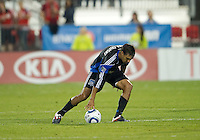 27 August 2011: San Jose Earthquakes forward Chris Wondolowski #8 places the ball at centre field after scoring the equalizer during a game between the San Jose Earthquakes and Toronto FC at BMO Field in Toronto..The game ended in a 1-1 draw.