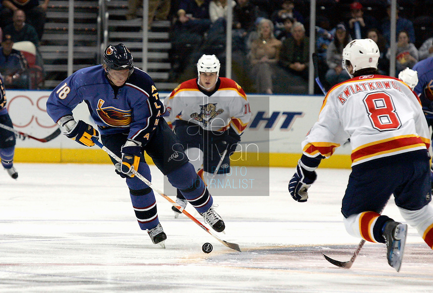 Atlanta Thrashers right wing Marian Hossa (18) faces Florida Panthers defenseman Joel Kwiatkowski (8) in the first period against the  at Philips Arena. The Thrashers won the game 1-0.<br />