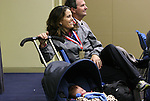 15 January 2009: Hall of Famers Julie Foudy and Anson Dorrance (behind) watch the press conference as Foudy rocks her infant child. The election announcement press conference was held at the Convention Center in St. Louis, Missouri in conjuction with the National Soccer Coaches Association of America's annual convention.