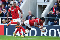 Jack Ram of Tonga dives for the try-line. Rugby World Cup Pool C match between Tonga and Namibia on September 29, 2015 at Sandy Park in Exeter, England. Photo by: Patrick Khachfe / Onside Images