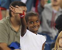 New England Revolution fan. In a Major League Soccer (MLS) match, the New England Revolution (blue) defeated D.C. United (white), 2-1, at Gillette Stadium on September 21, 2013.