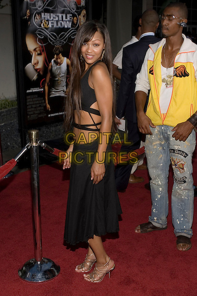 """MEAGAN GOOD.At the """"Hustle & Flow"""" Los Angeles Film Premiere,.held at the Arclight Cinerama Dome, .Hollywood, California, USA, 20th July 2005..full length black dress cut out sides tummy skin.Ref: ADM.www.capitalpictures.com.sales@capitalpictures.com.©Zach Lipp/AdMedia/Capital Pictures."""