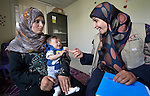 Zeinab El Hilawy (right), a lactation specialist from International Orthodox Christian Charities, a member of the ACT Alliance, talks with Maryam Ismael and her five-month old son Yasser in the community health center in Kab Elias, a town in Lebanon's Bekaa Valley which has filled with Syrian refugees. Ismael is a Syrian refugee, and difficulties with breast feeding have contributed to her son's malnutrition. Lebanon hosts some 1.5 million refugees from Syria, yet allows no large camps to be established. So refugees have moved into poor neighborhoods or established small informal settlements in border areas. International Orthodox Christian Charities provides support for the community clinic in Kab Elias, which serves many of the refugees.