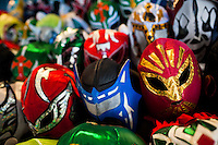 Colorful Lucha libre (Mexican wrestling) masks, inspired by those worn by professional wrestlers, for sale in a street shop in Mexico City, Mexico, 29 May 2011. Lucha Libre, 'free wrestling', is a unique Mexican sporting event characterized by the use of colorful masks. Masks (máscaras) have been a part of Lucha Libre since its inception in the early 20th century. The use of the masks in wrestling is related to the Aztec civilization and culture. In modern lucha libre, masks play an important part of the fight storyline, they are colorfully designed to evoke the images of animals, gods, ancient heroes, and other archetypes, whose identity the wrestler takes on during the fight.