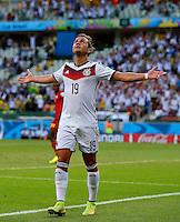 Mario Goetze of Germany celebrates scoring his goal to make the score 1-0