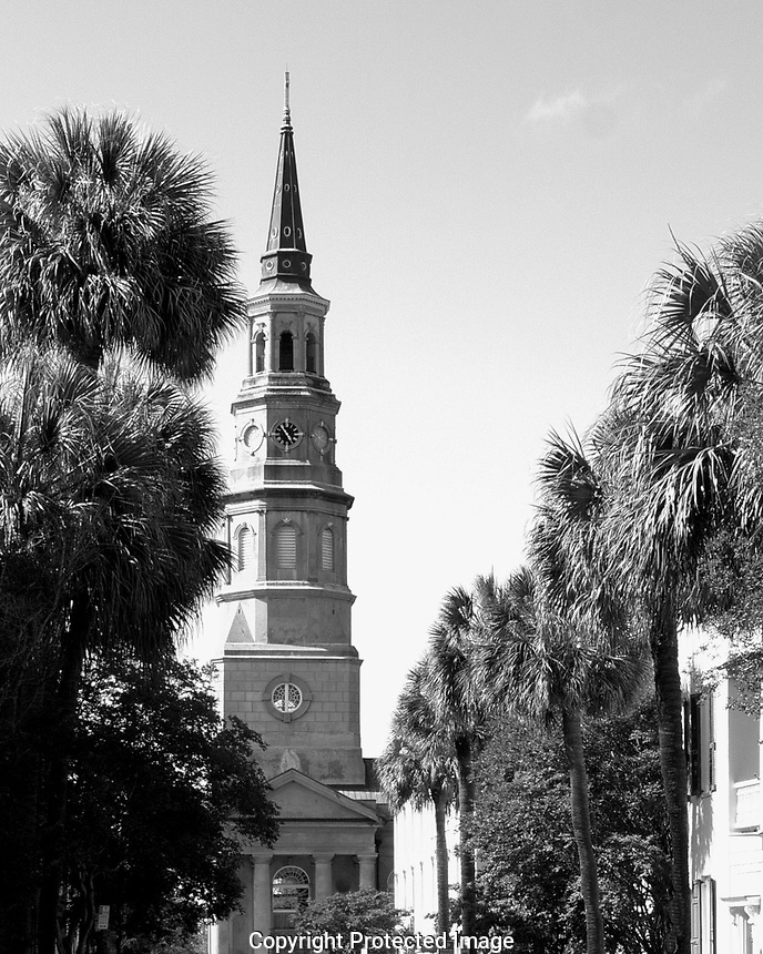 Established in 1681, St. Phillip's is the oldest religious congregation in South Carolina. The first St. Phillip's Church, a wooden building, was built between 1680 and 1681 at the corner of Broad and Meeting streets on the present day site of St. Michael's Episcopal Church. It was damaged in a hurricane in 1710 and a new St. Phillip's Church was begun a few blocks away on Church Street. After being delayed it was finished in 1723 but burned to the ground in 1835. Work on the present church was begun that same year and completed the next. The steeple was added between 1848 and 1850. A prominent early rector of St. Phillip's was Rev. Thomas Frost, a fellow of Caius College, Cambridge, who became rector of St. Phillip's in 1785. Rev. Frost died in 1804 at 46 years of age. Rev. Thomas Downes Frost, son of the first rector Frost, was elected assistant minister of St. Phillip's on March 12, 1815. The second Rev. Frost died an early death at age 26 in 1819.<br /> <br /> The wife of another early rector, Gideon Johnston, was Henrietta Johnston, who became the first recorded female artist in the American colonies. Another artistic first with connections to the church was Mary Roberts, the first female American miniaturist, whose burial was recorded in the register in 1761. The tower of St. Phillip's served for many years as the rear tower of a set of range lighthouses serving to guide mariners into Charleston's harbor; the front tower of the range was located on Fort Sumter. The church is one of only two in the United States known to have served such a function.
