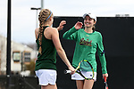 WINSTON-SALEM, NC - MARCH 17: Notre Dame's Mary Closs (right) and Monica Robinson (left) after winning a doubles point. The Wake Forest University Demon Deacons hosted the University of Notre Dame Fighting Irish on March 17, 2017, at Wake Forest Tennis Center in Winston-Salem, NC in a Division I College Women's Tennis match. Notre Dame won the match 4-1.