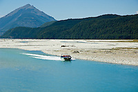 Jet boat full of tourists on Dart River, New Zealand