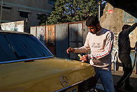 Gaza city, 21 Nov 2009.Filling a car in Gaza. Diesel coming through the tunnels from Egypt cost 1,50NIS or 25EUR cents per liter, roughly a third of the price from the 'legal' diesel.