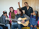 A guitarist leads students in singing during a class in the Instituto de Buena Voluntad (the Good Will Institute) in Montevideo, Uruguay. Sponsored by the Methodist Church of Uruguay, the institute works with youth and adults with disabilities. It receives financial support from United Methodist Women.