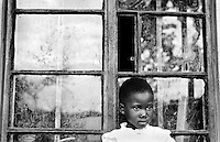 A young girl is among the lucky few to live in an orphanage in Kampala, Uganda on April 20, 2001.More than 13 million African children have been orphaned by the the AIDS pandemic. Worldwide, more than 20 million people have died since the first cases of AIDS were identified in 1981.