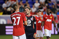 David Beckham (23) of the MLS All-Stars talks with Federico Macheda (27) of Manchester United after the match. Manchester United defeated the MLS All-Stars 4-0 during the MLS ALL-Star game at Red Bull Arena in Harrison, NJ, on July 27, 2011.