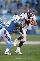 11/27/11 San Diego, CA: San Diego Chargers nose tackle Cam Thomas #76 and Denver Broncos quarterback Tim Tebow #15 during an NFL game played between the Denver Broncos and the San Diego Chargers at Qualcomm Stadium. The Broncos defeated the Chargers 16-13 in OT