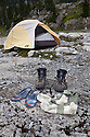 WA11010-00...WASHINGTON - Hiking boots outside a tent in Ferry Basin along the Bailey Traverse in Olympic National Park.