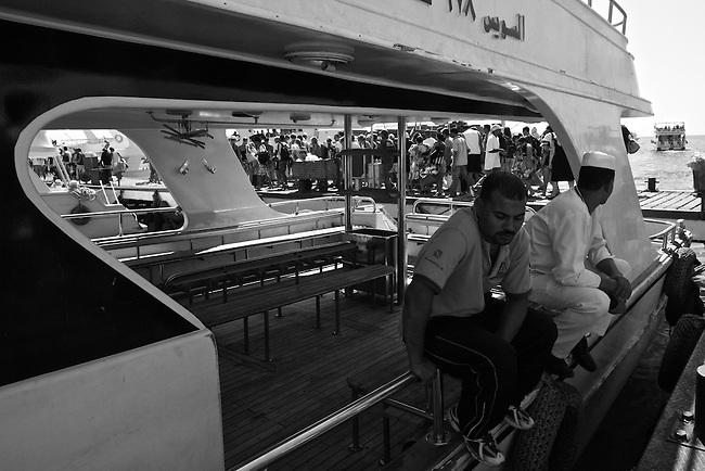 Boat crewmen wait for passengers on the dock at Sharm-el-Shiek, Egypt. Sept. 30, 2009.