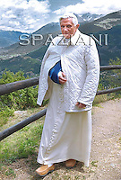 Pope Benedict XVI  goes for a walk in Les Combes, near Aosta, northern Italy,July 18, 2009.